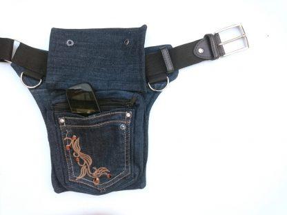 Heuptas van een oude spijkerbroek